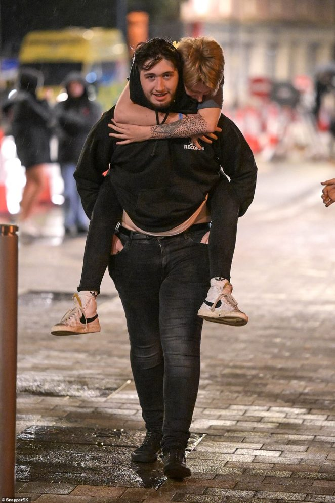 A student hitches a ride from a friend after enjoying the first night of Freshers' Week