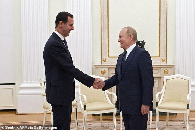 Vladimir Putin has entered self-isolation after a member of his entourage contracted Covid-19 a day after meeting Syrian presidentBashar al-Assad
