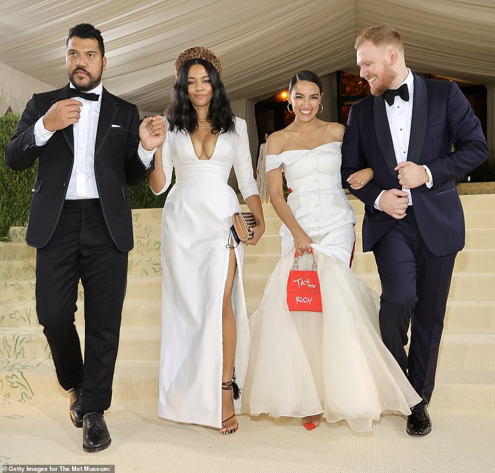 AOC with her boyfriend Riley Roberts (far right), her dress designer Aurora James and Benjamin Bronfman (far left), James' partner who is the heir to Seagrams Company Ltd.