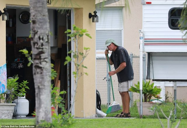 Laundrie's father Chris was seen sweeping outside the home on Monday
