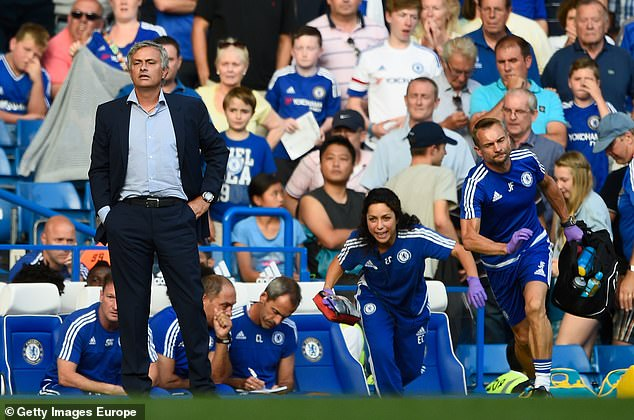 Chelsea's medical team of Eva Carneiro and Jon Fearn rush on to treat Eden Hazard in the latter stages of Chelsea's 2-2 draw with Swansea City as Jose Mourinho looks on