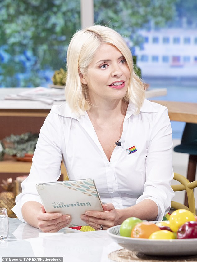 Conflicting Opinions: Holly Willoughby caught herself between two opinions on Tuesday morning over teens receiving the COVID-19 vaccine.