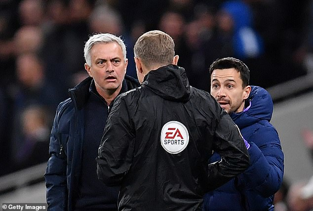 Mourinho confronts the fourth official over not given Raheem Sterling a second yellow card during his Tottenham side's 2-0 win over Manchester City in 2020