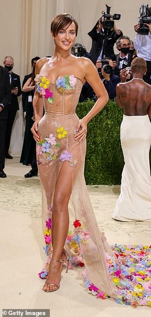 Stunning: Irina's beige off-the-shoulder dress featured a bustier that emphasized her hourglass figure