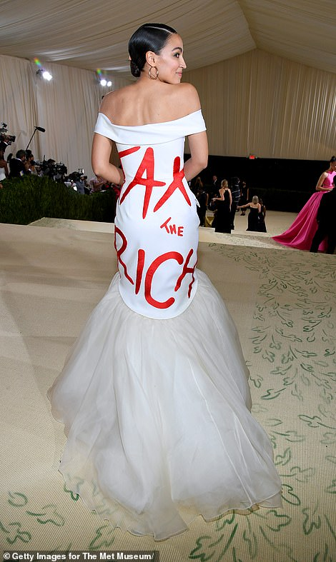 Alexandria Ocasio-Cortez attends the lavish Met gala wearing a 'TAX THE RICH' dress