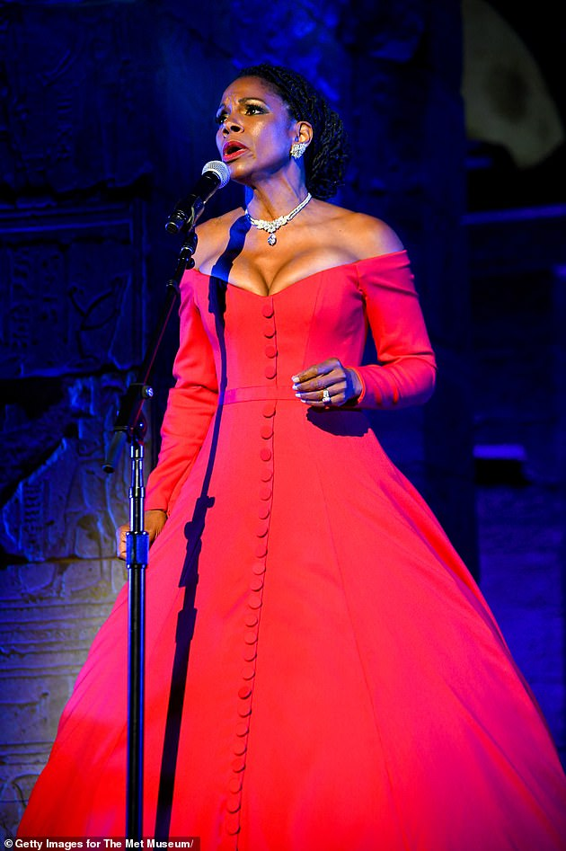 Superstar:The 51-year-old Respect actress took to the stage in a bright red off-the-shoulder ballgown with buttons up the front