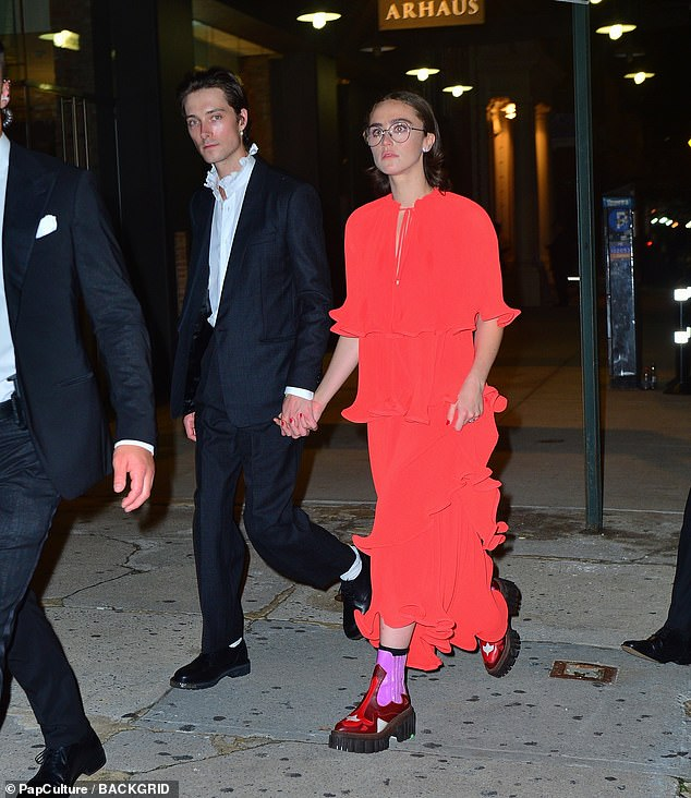 Ella Emhoff changed into a more casual look after leaving the Met Gala on Monday night. Emhoff, pictured here with boyfriend Sam Hine, wore a red dress layered with ruffles going down to her ankles