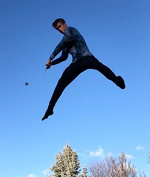 Astonishing footage of the trick shot sees Dylan, who describes himself as a garden trampoline athlete, throw a ball in the air while jumping off a trampoline