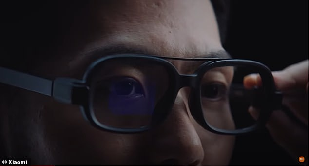 The Chinese electronics company released a teaser video showing a black pair of glasses designed with a total of 497 components, including miniature sensors and communications modules, which the firm says make the device more than 'just a second screen'. makes.