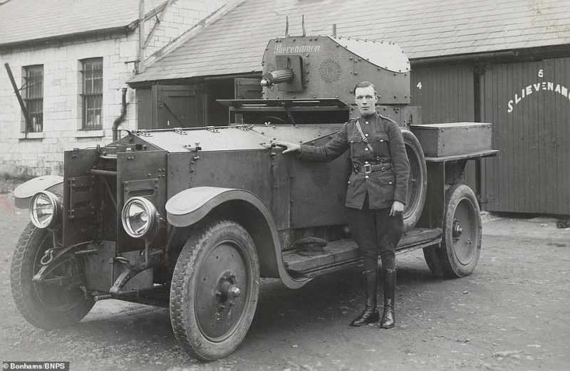 A soldier stands besides a Slievenamon armoured car in a picture stamped April 18, 1924, by T.J. O'Brien of Cork