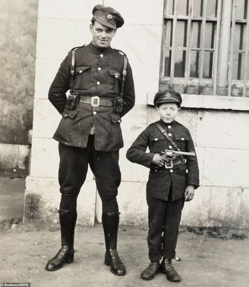 The alarming sight of a boy in uniform holding a gun next to an adult combatant features among the photos in the collection