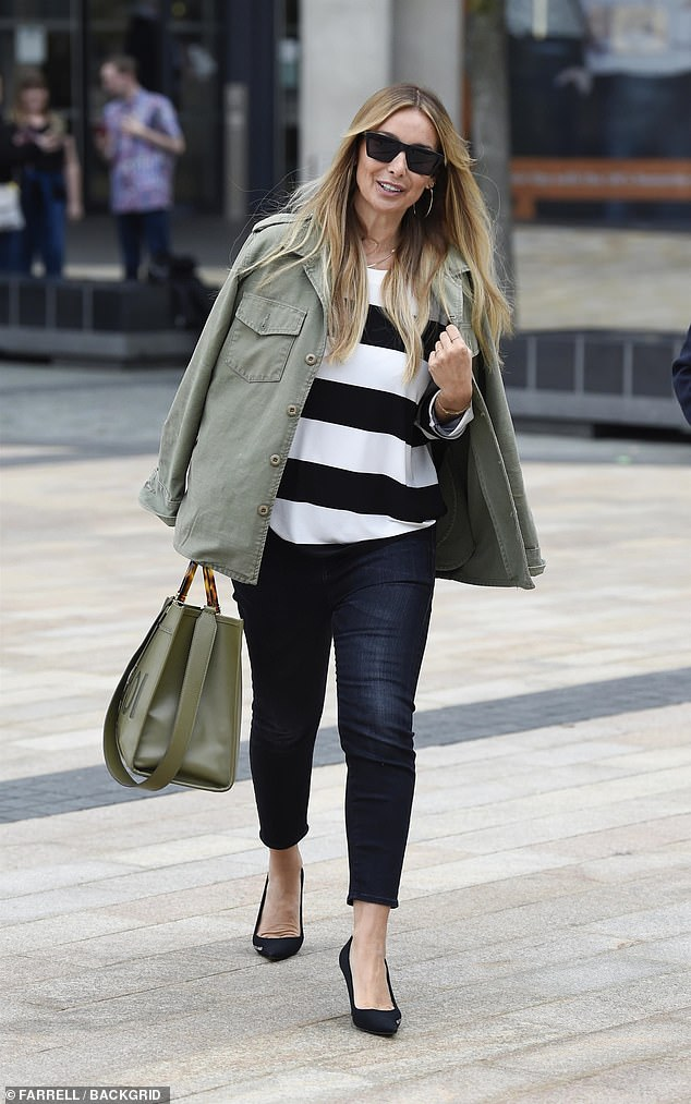 Work it! Louise completed her look with a black and white stripped jumper and dark denim jeans