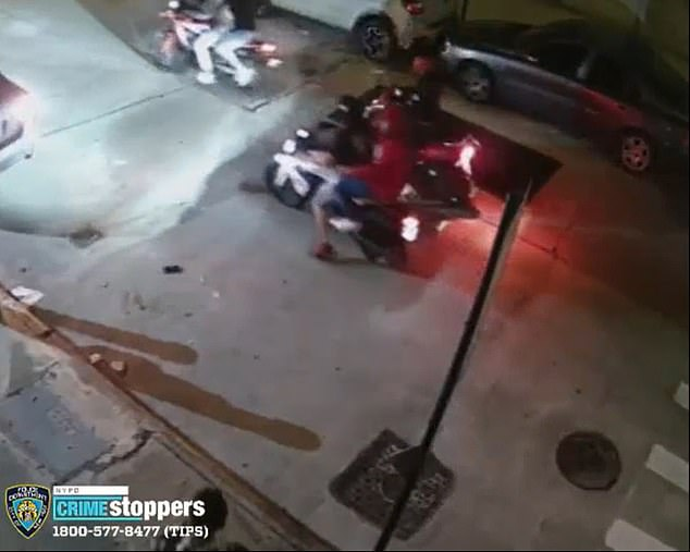 The motorcyclists drive off with the newly stolen BMW as they leave the driver behind