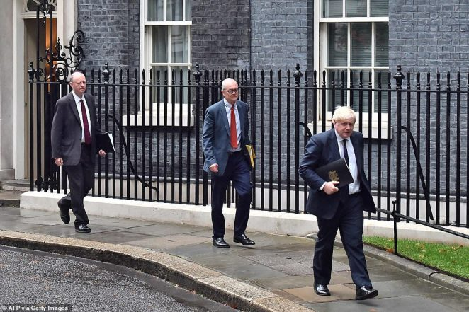 Mr Johnson (right), Patrick Vallance (centre) and Chris Whitty (left) leave No10 for the press conference at No9 today