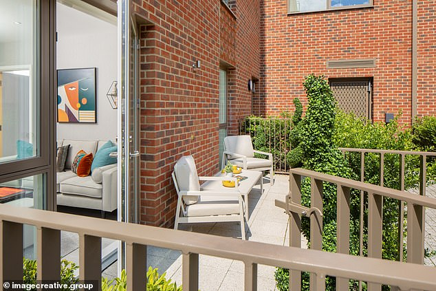 The apartment has a small terrace that juts back to a large shared garden