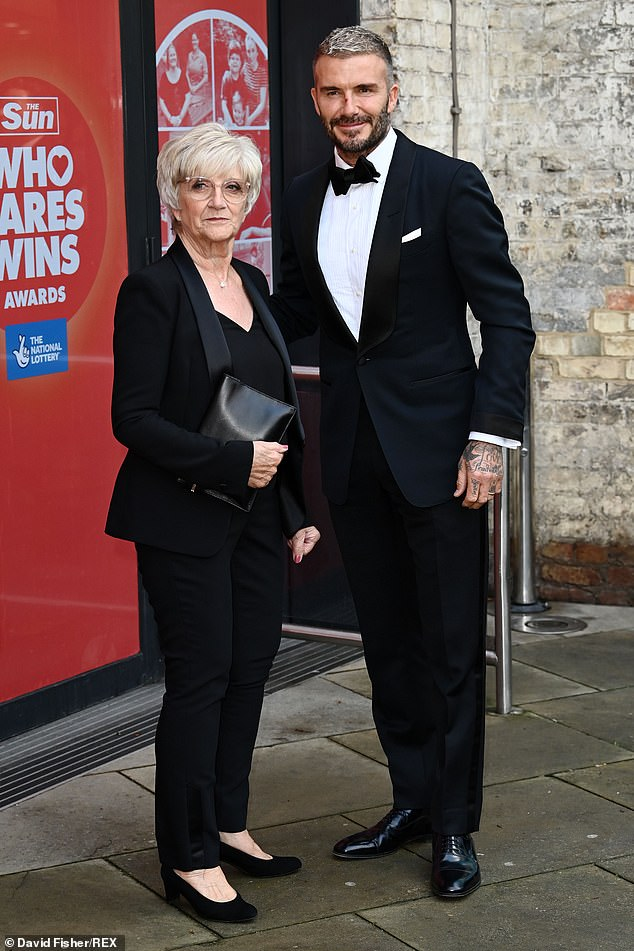Ouch!David Beckham sported a mystery scratch on his nose as he joined mum Sandra at Who Cares Wins Awards at The Roundhouse in London on Tuesday