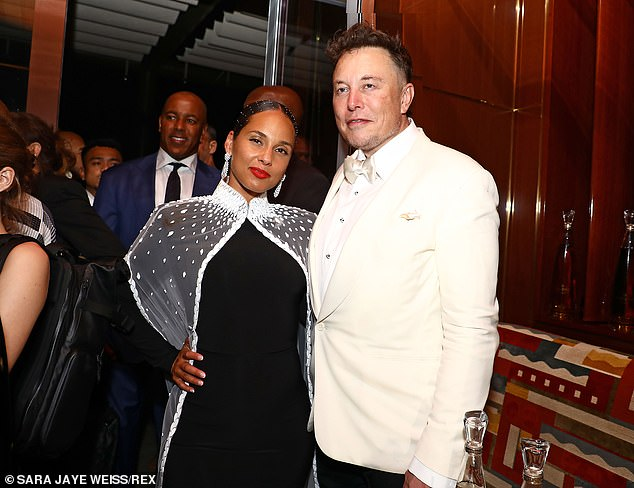 Friends in high places!  Fallin 'singer struck a pose with Elon Musk