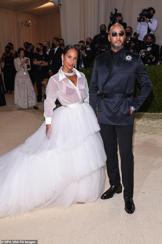 Looking good!  Keys wore a stunning white dress to the Met Gala with hubby Swizz Beatz