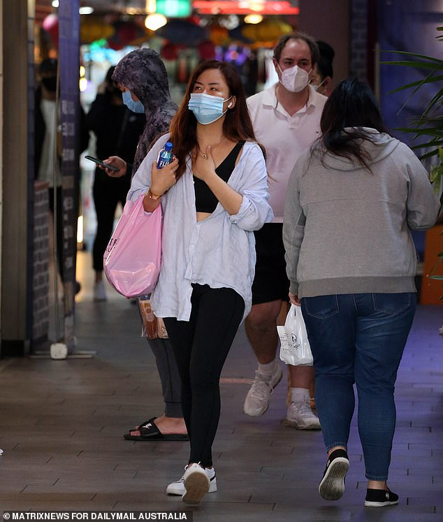 Thousands of residents in western Sydney suburbs with low rates of Covid transmission and high vaccination rates could be released from their tougher lockdown. Pictured are residents in Burwood in Sydney's inner-west