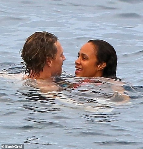 Cosy: The pair were giggling away as they cuddled up close to one another in the water