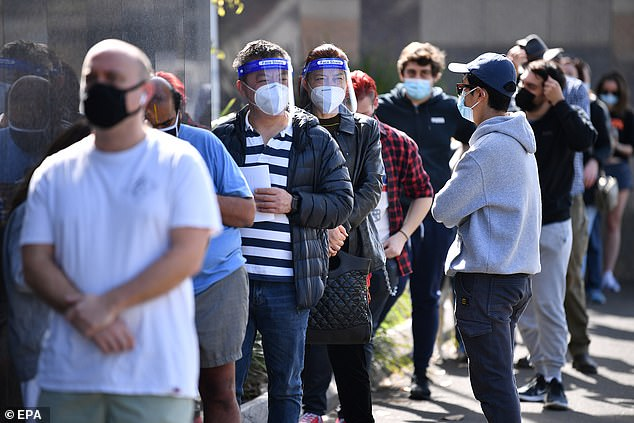 Pictured is a queue outside a Covid-19 pop-up vaccination clinic at Ashfield in Sydney's inner-west on September 10