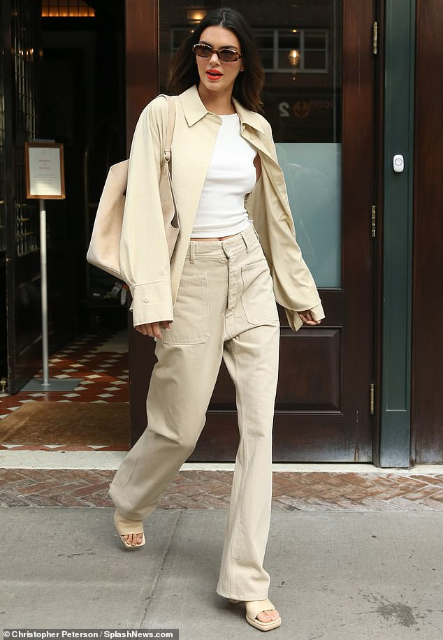 Cool in khaki: Kendall Jenner went for casual elegance while heading to tape The Tonight Show Starring Jimmy Fallon on Tuesday in New York