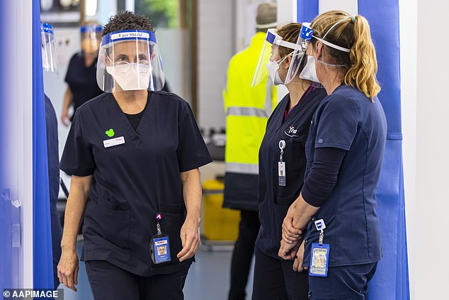 Health care workers at a Covid-19 vaccination hub at the Heidelberg Repatriation Hospital in Melbourne on Monday.All healthcare staff in Victoria must get a Covid-19 jab or risk losing their job as part of new government health orders