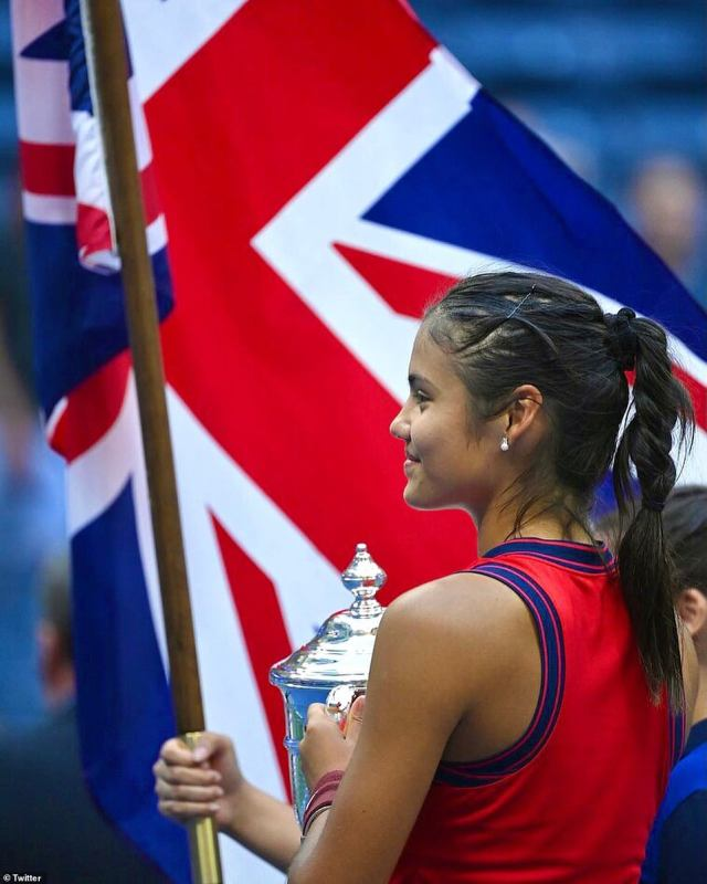 The British star waved the Union Jack as she held her trophy following her stunning win