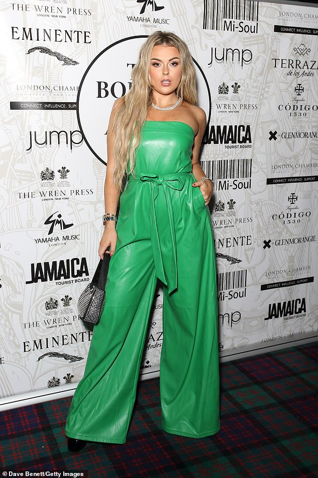 Showtime!Scottish singer-songwriter Tallia, 22, put on a show with her own ensemble - a bright green pleather jumpsuit with oversized bell-bottoms