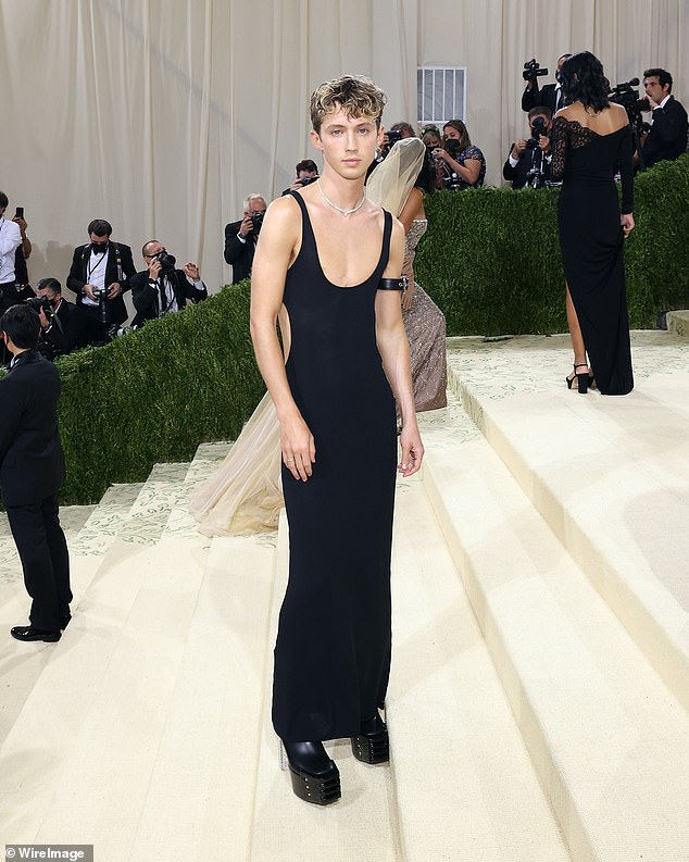 Turn heads: Troye looked amazing when he walked the Met Gala red carpet this week in her tight black dress.  The 26-year-old singer's outfit featured a deep plunging neckline and side cutouts