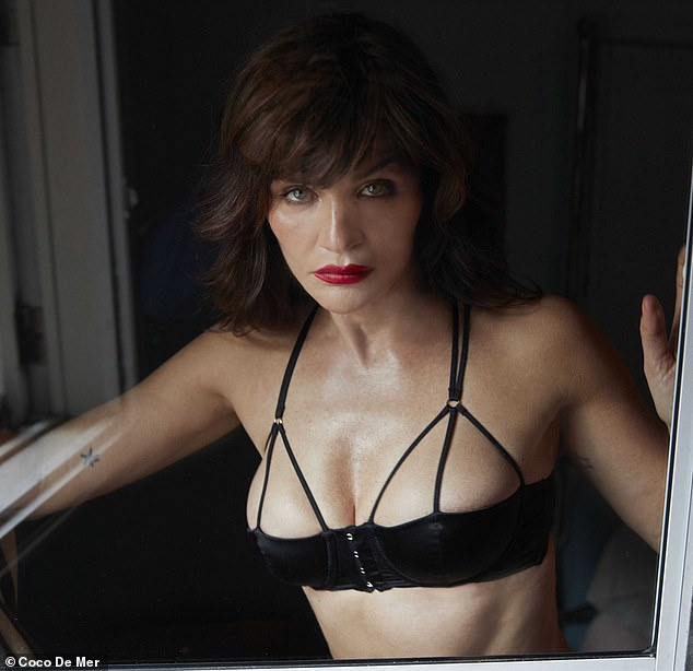 Smouldering:In another saucy snap, Helena sported just a black bra