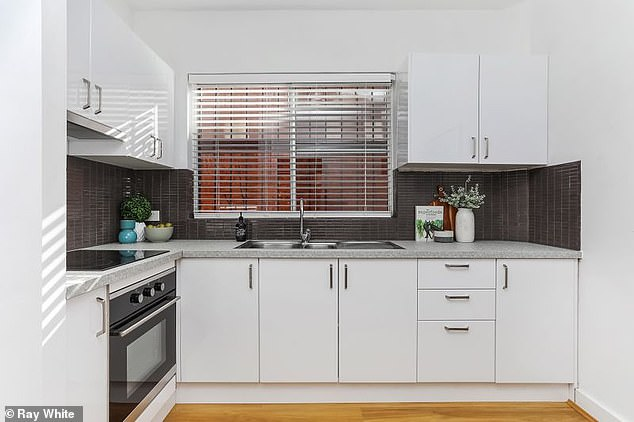 Neat and tidy: The kitchen has been renovated with the interiors updated with a fresh paint job along with stunning floating floors