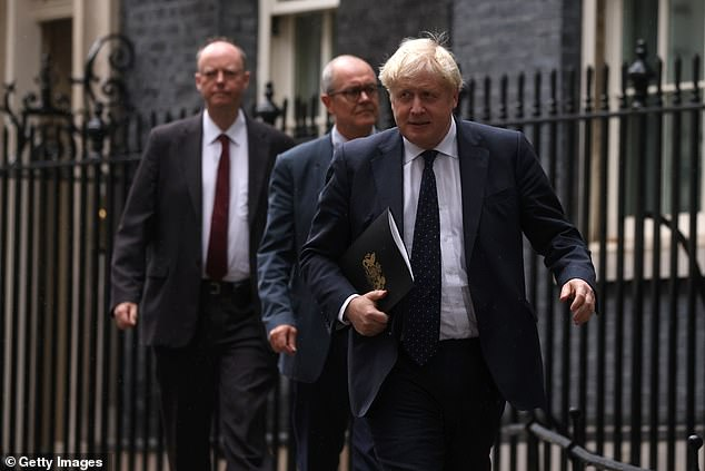 Playing politics: Chief Medical Officer for England Chris Whitty (left), Prime Minister Boris Johnson (R) and Chief Scientific Adviser Patrick Vallance (C) in Downing Street this afternoon