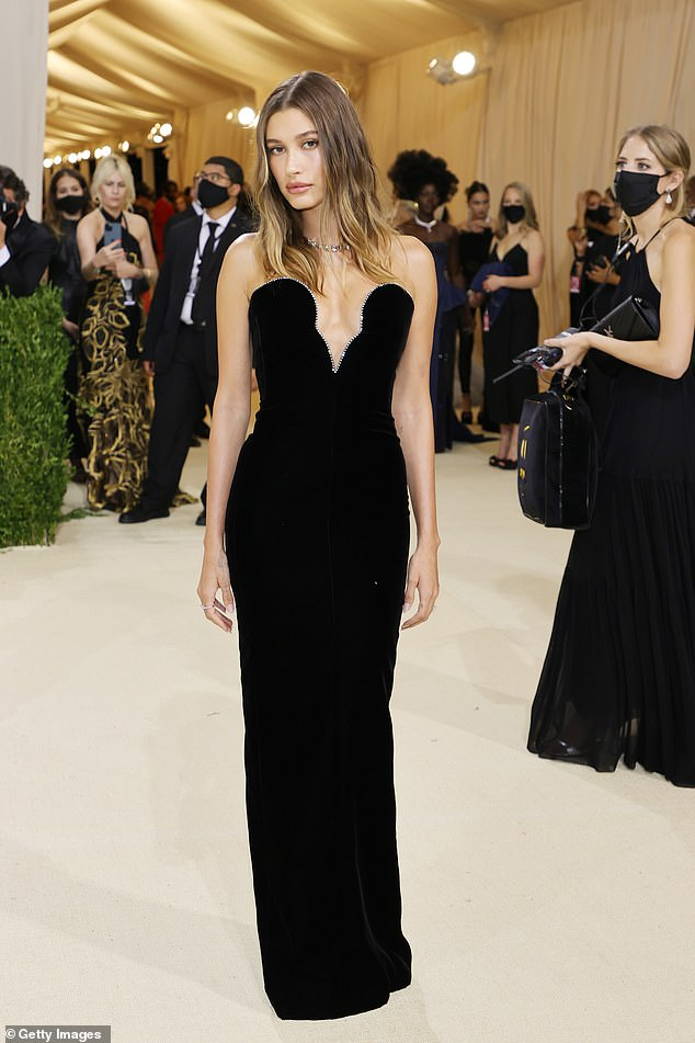 Gorgeous: Hailey donned an elegant strapless black Saint Laurent dress with crystals down her chest with Tiffany & Co jewelry.