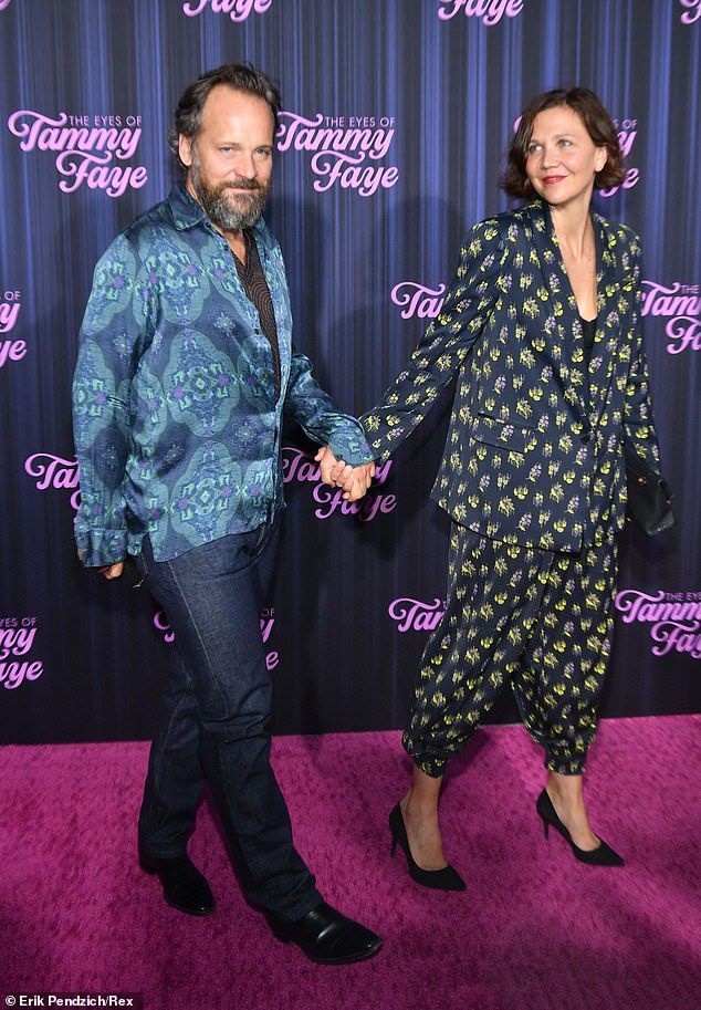 Holding hands:The couple, who wed in 2009, posed closely before walking the red carpet with their hands interlocked