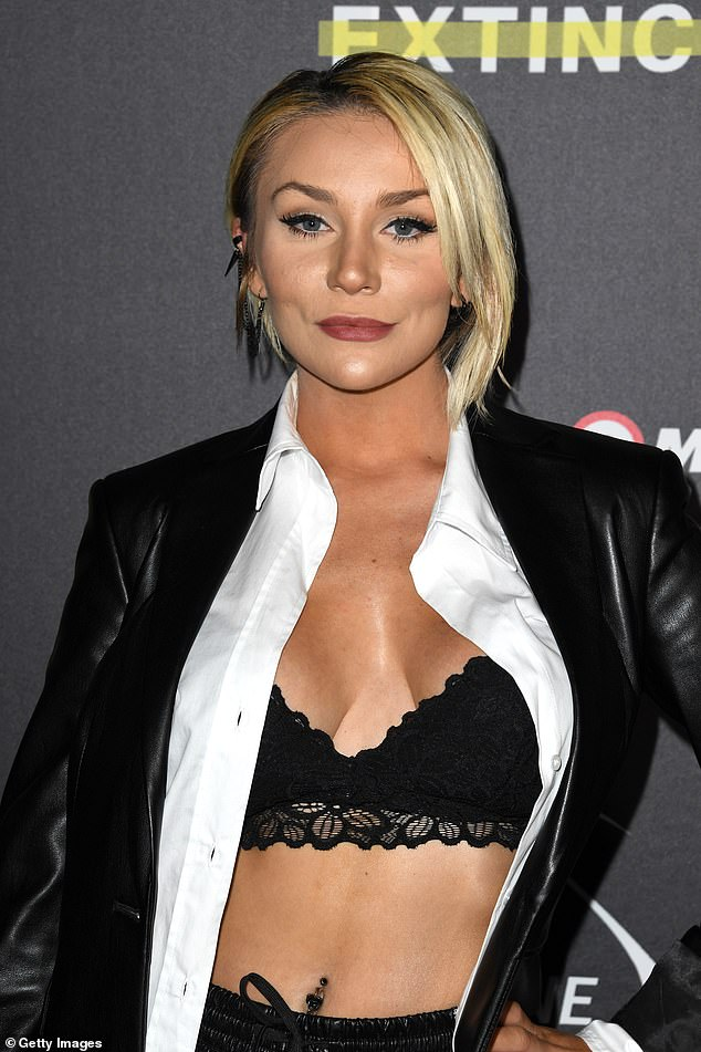 Stunning: The 27-year-old model, who came out as non-binary earlier this year and uses them / them pronouns, showed off her toned belly in a lacy black bra on the red carpet