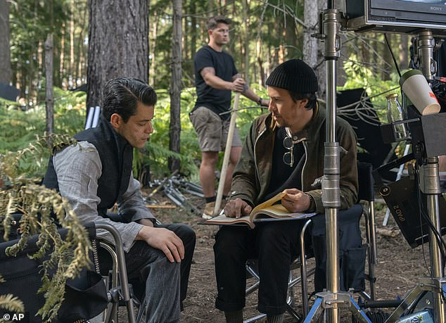 Rami and director:No Time to Die is directed by Cary Joji Fukunaga (right) from a script he co-wrote with James Bond writing mainstays Neil Purvis and Robert Wade.