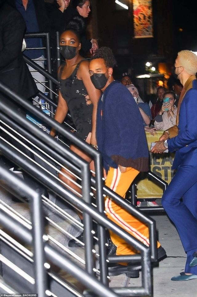 Event: Lewis also sported a pair of bright yellow tracksuit bottoms and black shoes and appeared to arrive at the bash with another woman