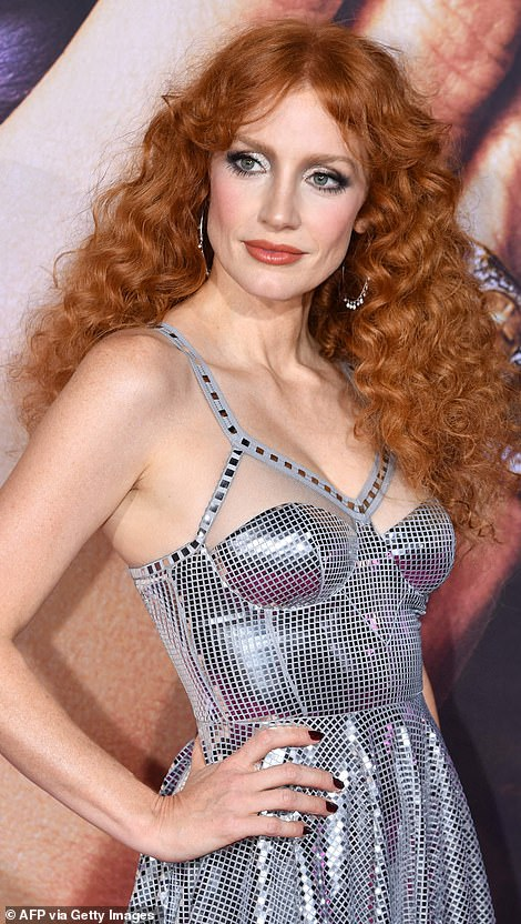 Chameleon: Jessica Chastain ditched her signature straight strands for a curly mane as she attended the star-studded premiere of The Eyes of Tammy Faye in New York; Jessica pictured on Tuesday