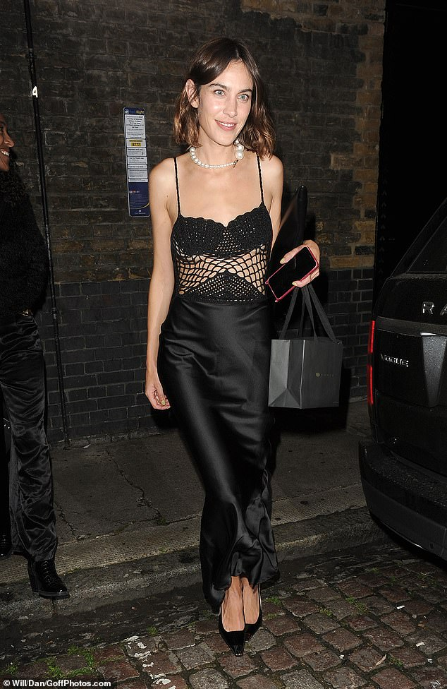 Wow! Alexa Chung looked sensational in a black crochet top and black satin skirt as she was pictured leaving Chiltern Firehouse in London on Tuesday night