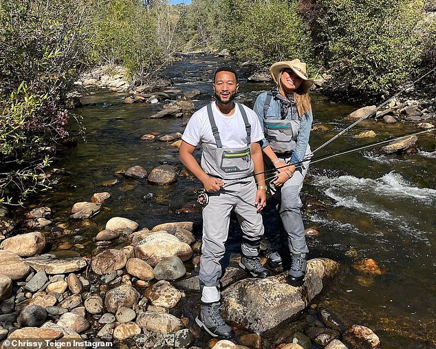 Back to basics:The stresses of city life were far behind Chrissy Teigen on Tuesday as she joined husband John Legend for a spot of fly-fishing in rural California