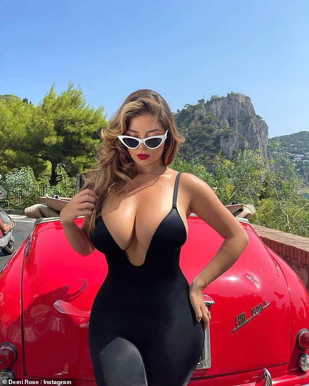 Sizzling: The model, 26, put on a very busty display as she showed off her ample cleavage in a plunging black unitard