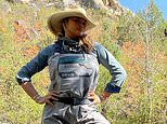 Chrissy Teigen pulls on her waders as she tries her hand at fly-fishing with husband John Legend