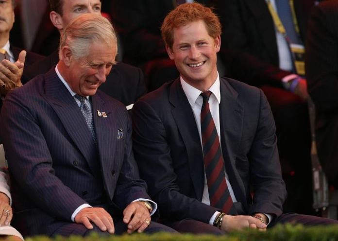 The Duke of Sussex and his father are pictured sharing a sweet moment at the Invictus Games opening ceremony in September 2014