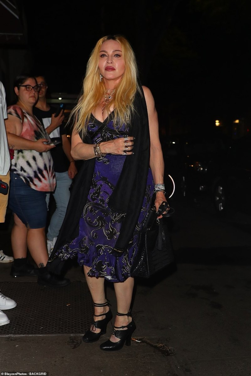 Icon: Madonna looked great in her flattering dress and accessorized with a pair of silver cross earrings