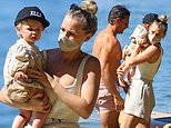 Anna Heinrich and Tim Robards enjoy a family day at the beach with their 10-month-old daughter Elle