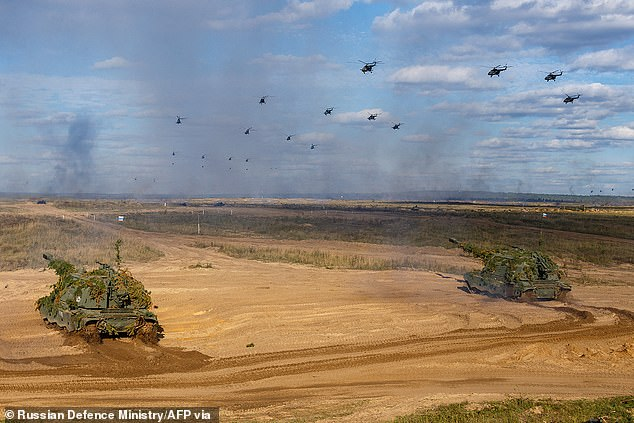 Tanks and helicopters are seen during drills at theMulino army base in the Nizhny Novogorod region on Monday