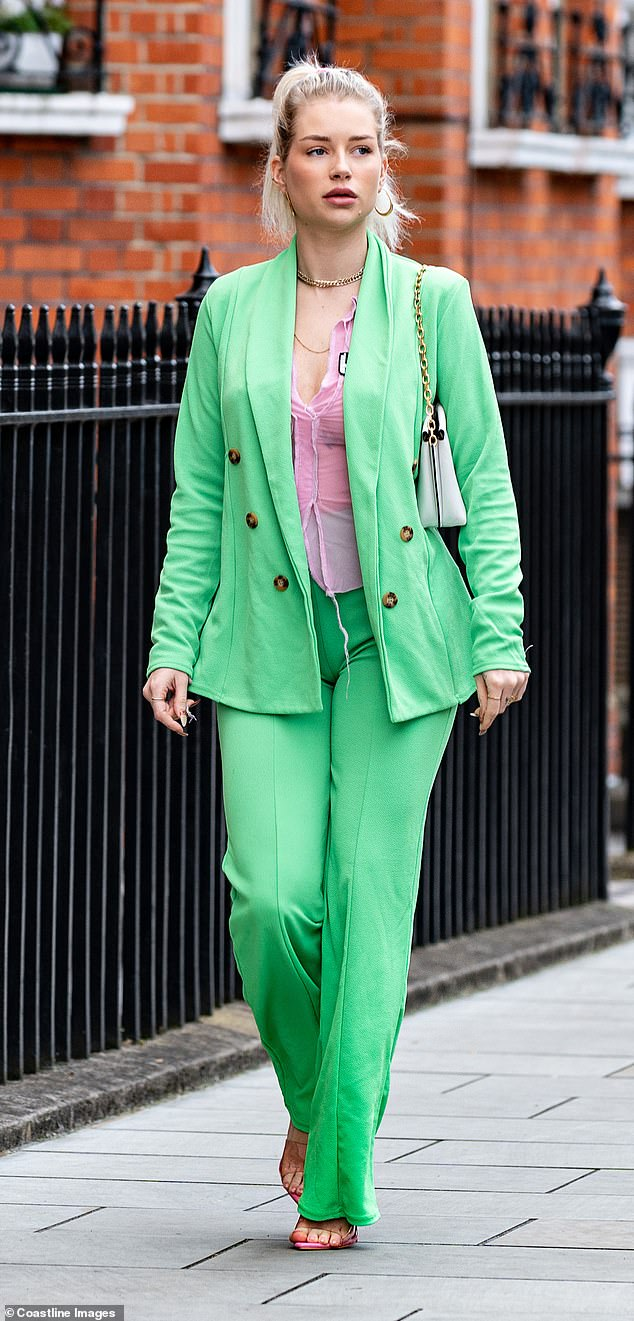 Turning heads: The OnlyFans star stood out in a bright green suit as she showcased her assets in the plunging see-through blouse