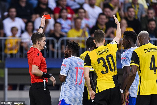 Wan-Bissaka is shown the red card following his late tackle in the first half on Tuesday