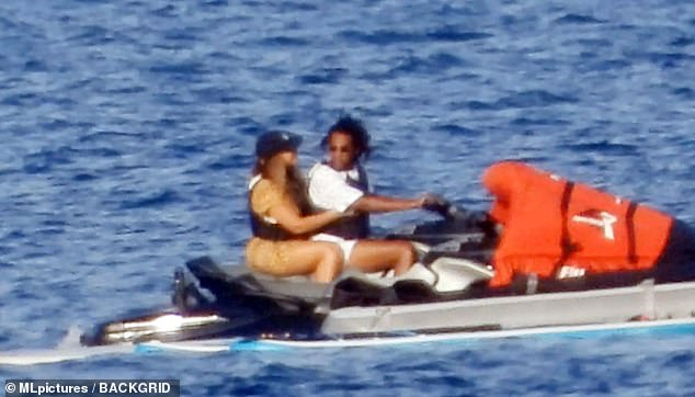 Here we go: Jay-Z looked back at his wife as they set off across the Med on Wednesday